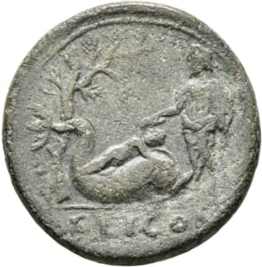 Reverse of Coin with Palaimon on back of dolphin and Sisyphus
